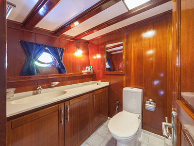 Toilet and sink in a bathroom on a gulet ship