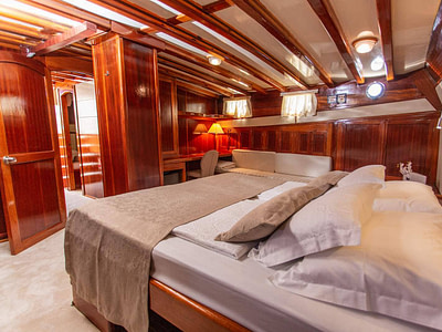 Luxurious wooden cabin with a large double bed
