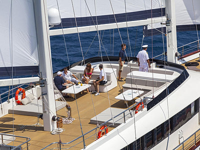 Guests and captain on a large sailing yacht