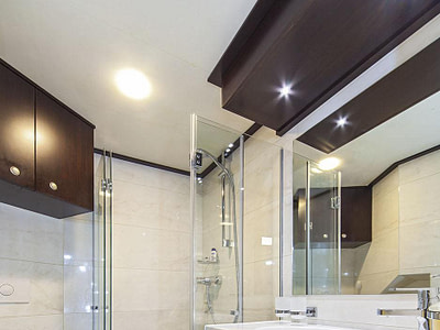 Guest shower, toilet and sink inside a luxury sailing yacht