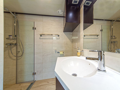 Modern luxurious bathroom with a shower and sink inside a sailing yacht