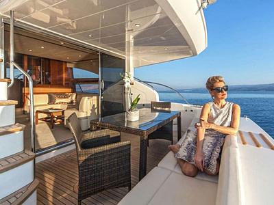 Guest sitting onboard luxury motor yacht