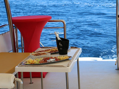 Champagne and domestic snacks on a table on a pontoon boat