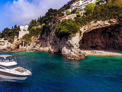 Prestige 440 yacht cruising next to a cave off the coast of Dubrovnik , Croatia