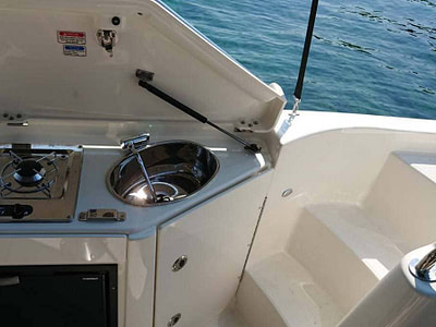 Outdoor and sink onboard a Quicksilver 805