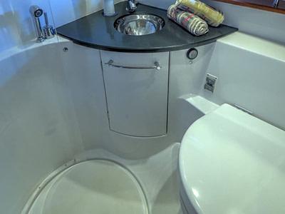 Indoor shower and toilet onboard a Prestige 440