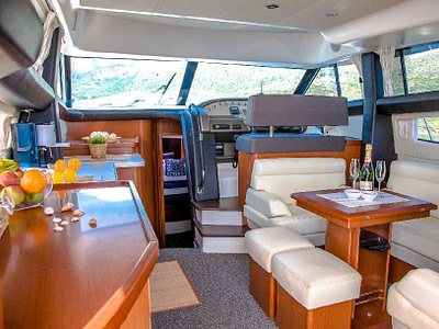 Interior details in a spacious saloon and cockpit with wide windows onboard a Prestige 440