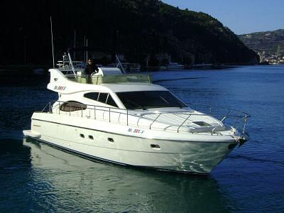 Captain onboard a Ferretti 480 yacht near the coast