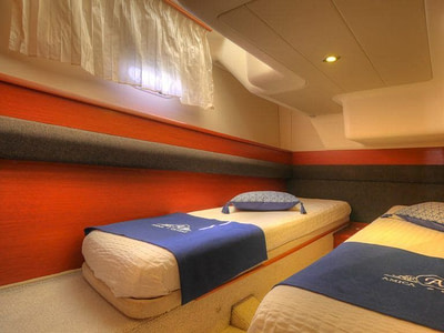 Cabin with two single beds onboard a Prestige 440 FLY