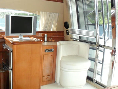 Saloon interior and TV onboard a Ferretti 480 yacht