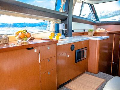 Kitchen interior and wide windows onboard a Prestige 440 yacht