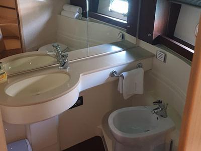 Ensuite bathroom onboard a Ferretti 591 yacht