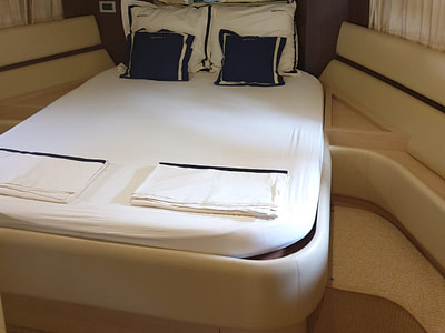 Double bed in a cabin onboard a Ferretti 591