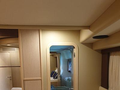 Cabin and bathroom entrance onboard a Farretti 591