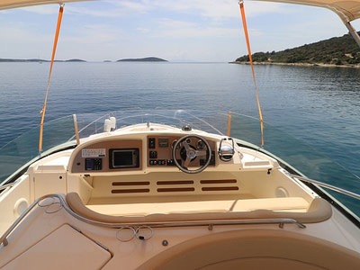 View of sea and islands from the top deck cockpit of a motor yacht