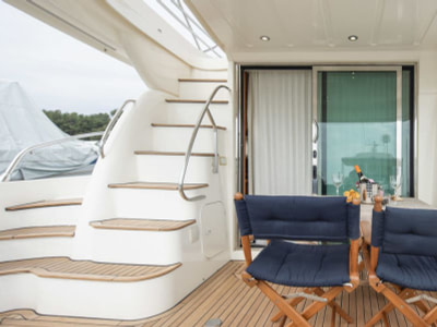 Teo chairs and a staircase at the back of a Prestige 46 motor boat