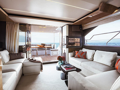 Luxury yacht saloon with white leather couches