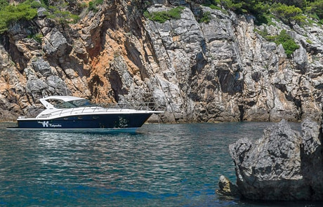 anchored motor yacht next to the blue cave on Kolocep island in Dubrovnik