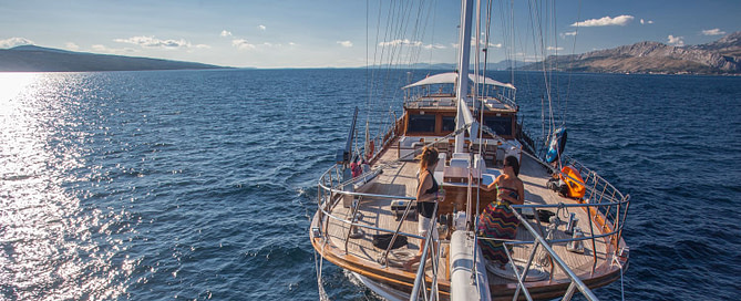 Guests sailing on large wooden ship