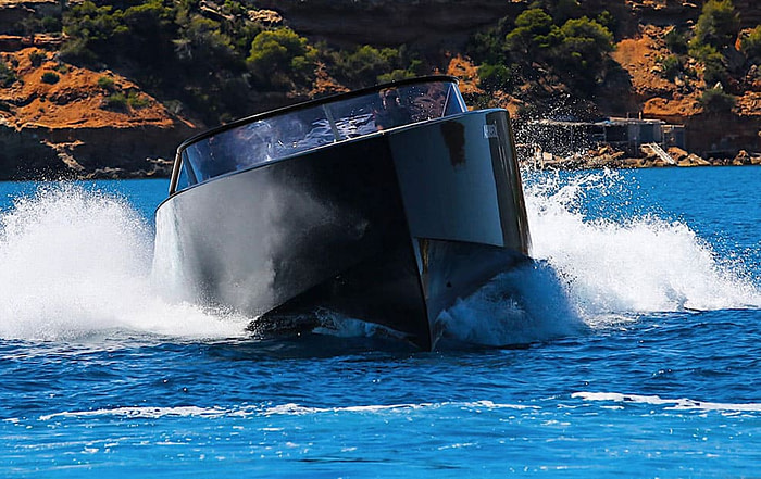 Luxury Von Dutch yacht cruising in the sea making waves