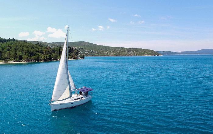 Birds view of a Sun Odyssey 32 sailing in Croatia