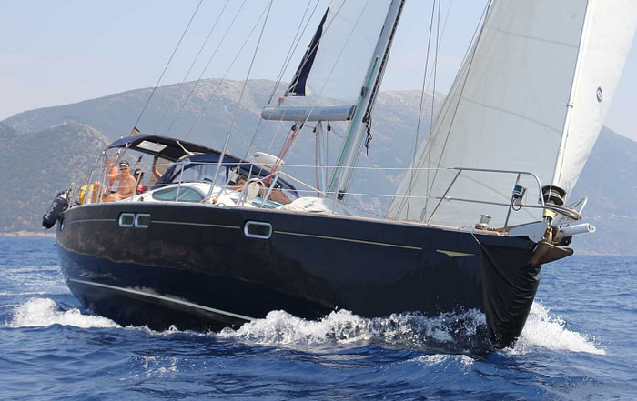 Side view of a Sun Odyssey 54 sailing in the sea