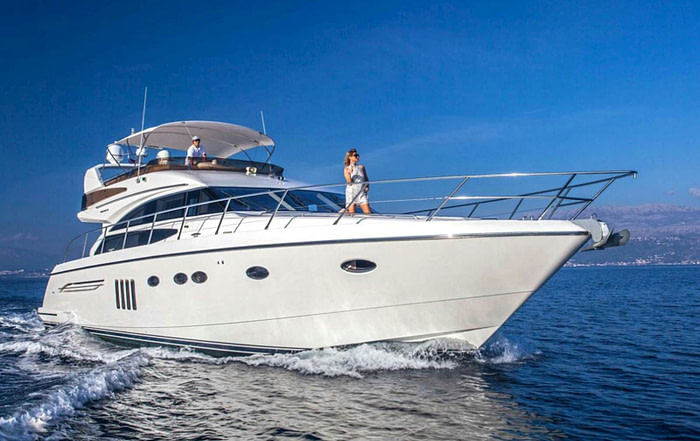 Captain and guest cruising on motor yacht